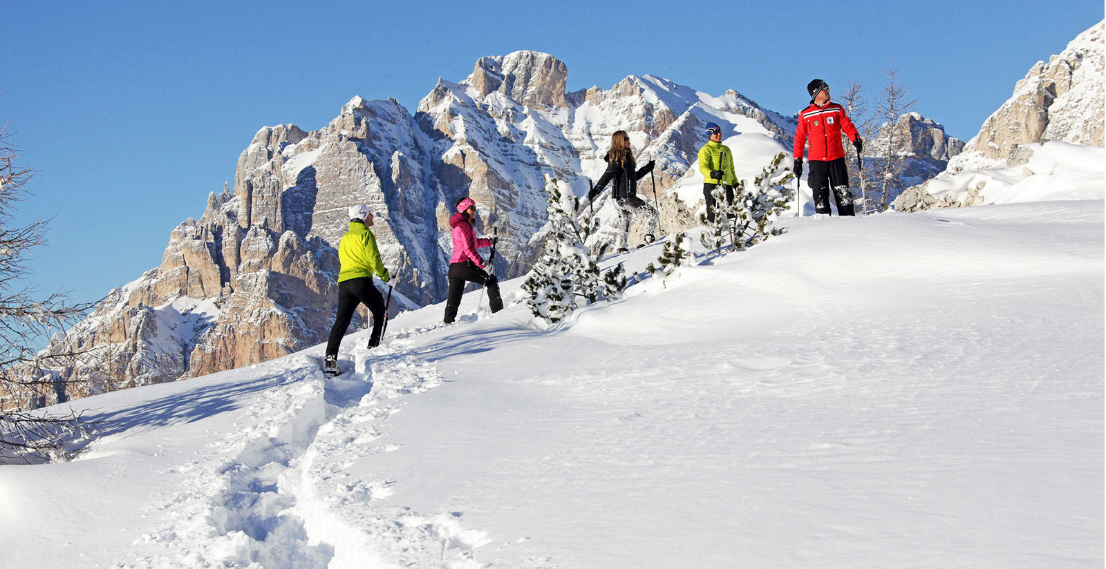 Wintertime hiking and bobsledding <br>in Alta Badia
